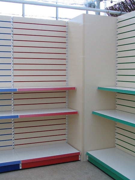 Shop Shelving with colored inserts and slatwall. easy to add shelves, pegs and shopfitting accessories.