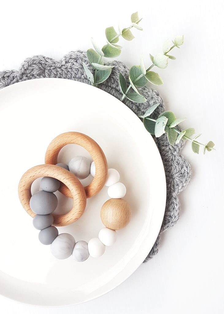 Made from gorgeous Beech timber and soft, Marbled grey Bpa-free silicone, these teething toys have been designed to soothe sore teething gums and encourage healthy fine motor skills development and brain function - Dreamer Marble Teething Toy - Bowerbird Creations