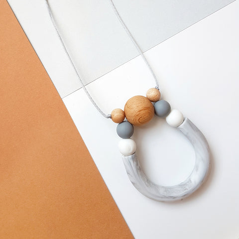 Created using a marble U tube especially for the modern woman. Featuring three Beech timber beads to make a beautiful statement necklace which also gives off the very softest 'rattle' sound when worn - Freya Ladies Necklace - Bowerbird Creations
