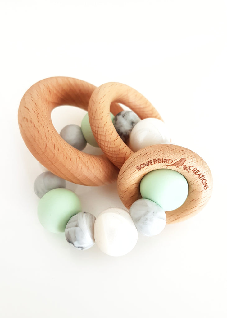 This little Teething Toy with Three different sized Beech Timber rings makes THE most beautiful rattle sound out of all of our Teethers!    - Saturn Teething Toy - Bowerbird Creations