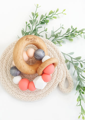 Made from gorgeous Beech timber and soft Bpa-free silicone, these teething toys have been designed to soothe sore teething gums and encourage healthy fine motor skills development and brain function - Eclipse Teething Toy - Bowerbird Creations
