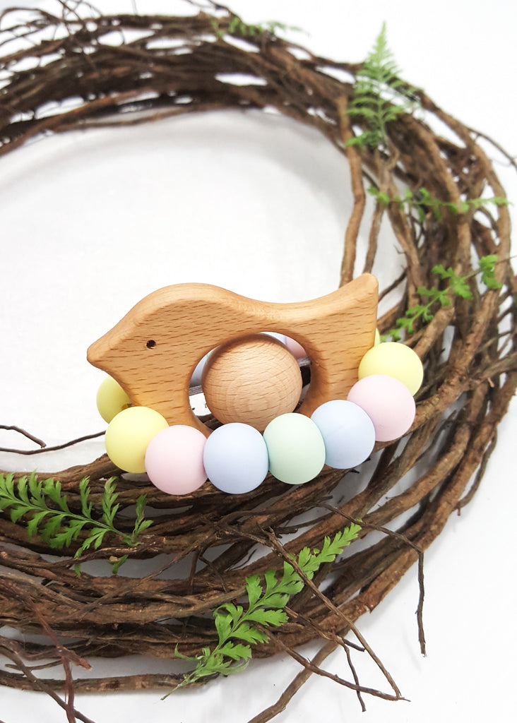 The Rattle 'n' Tweet Teething & Sensory Toy features a Large Beech timber bead which softly rattles on the the little timber bird when shaken.  An exclusive and original design to BowerBird Creations,these little birds in a nest boast a variety of colours shapes & Textures - Rattle 'n' Tweet Teething Toy - Bowerbird Creations