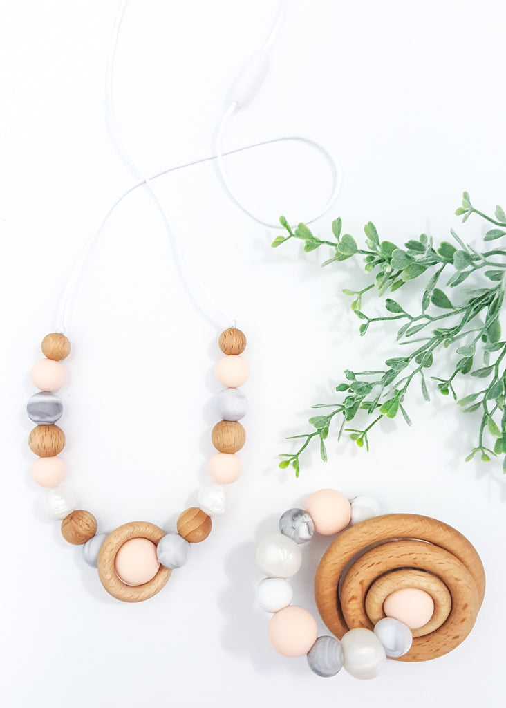 This stunning Peach collection features a Teething rattle for Baby and a gorgeous matching necklace for Mum. Available as a set or separately. - Saturn Set (also available separately) - Bowerbird Creations