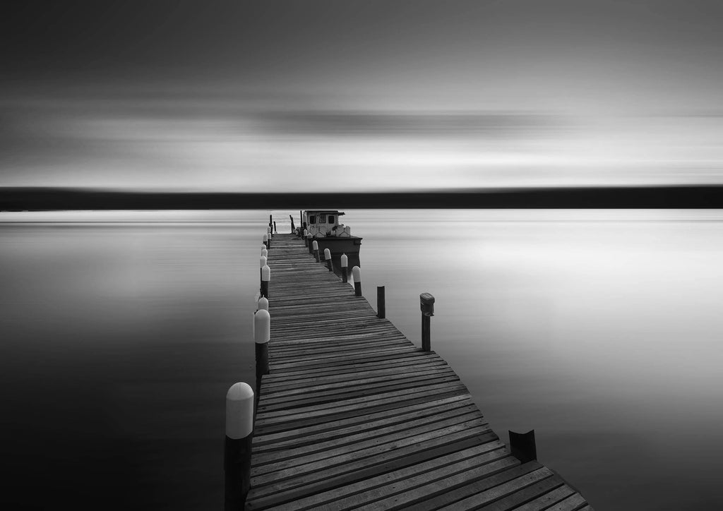 PIER WITH BOAT: Black and White Photography Print - The Print Arcade