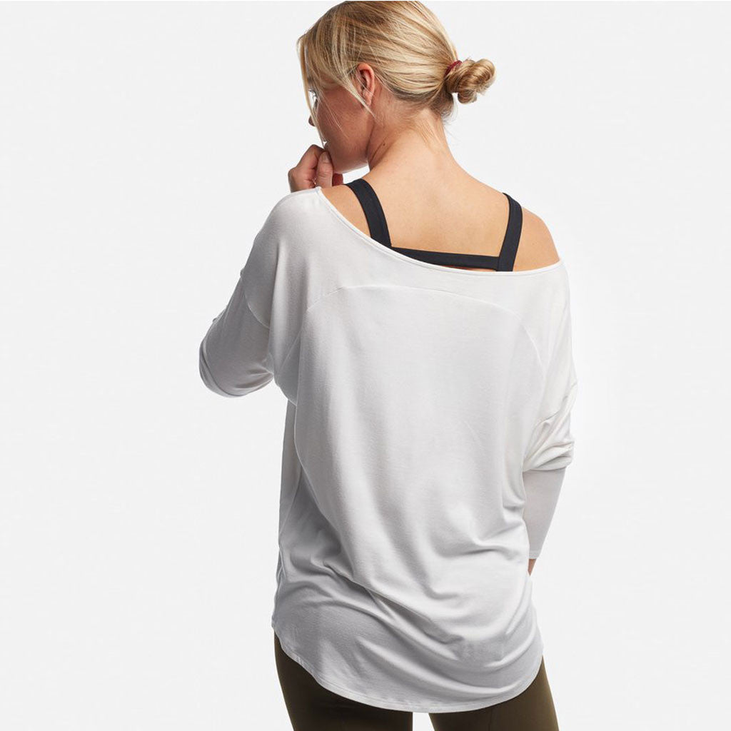 Relaxed fit white long sleeve off the shoulder top by Haven Collective.