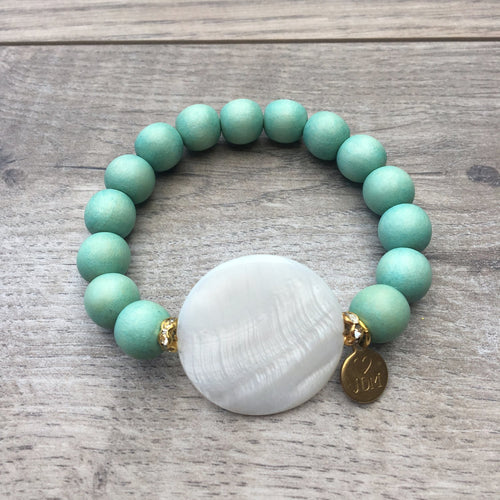 Mint wood beaded bracelet with mother of pearl and gold pave accents.