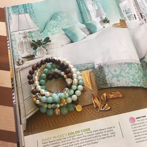 Stack of Jom bracelets in mint hues perfect for summer.