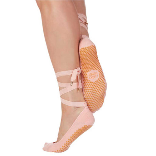 Lucky Honey pink grip socks with removable ankle ties.