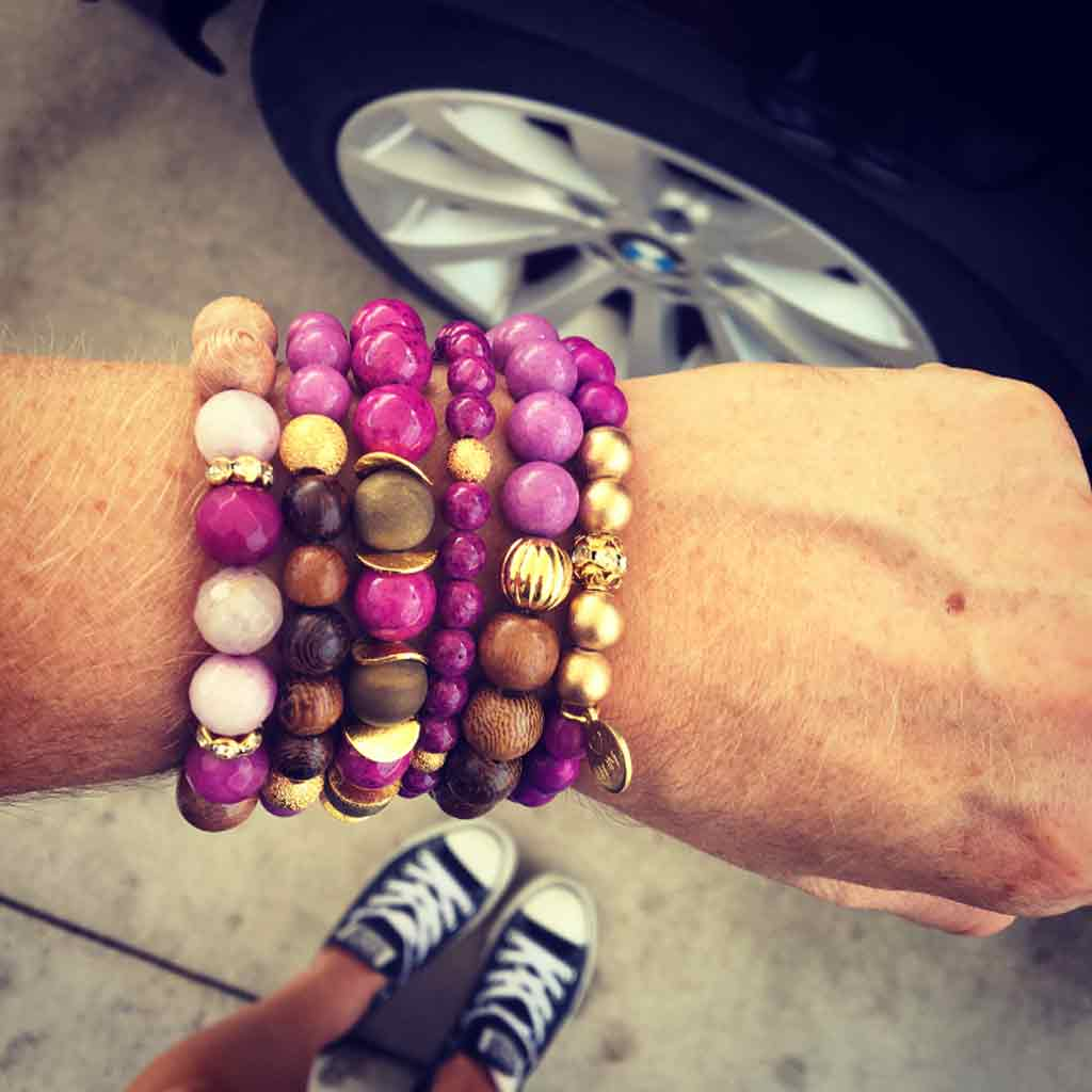 Mystic Merlin gemstone bracelets stacked for a party on your arm.