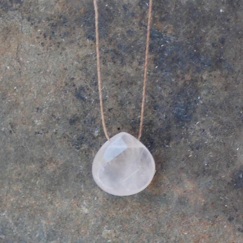 Rose quartz necklace to support breast cancer awareness.