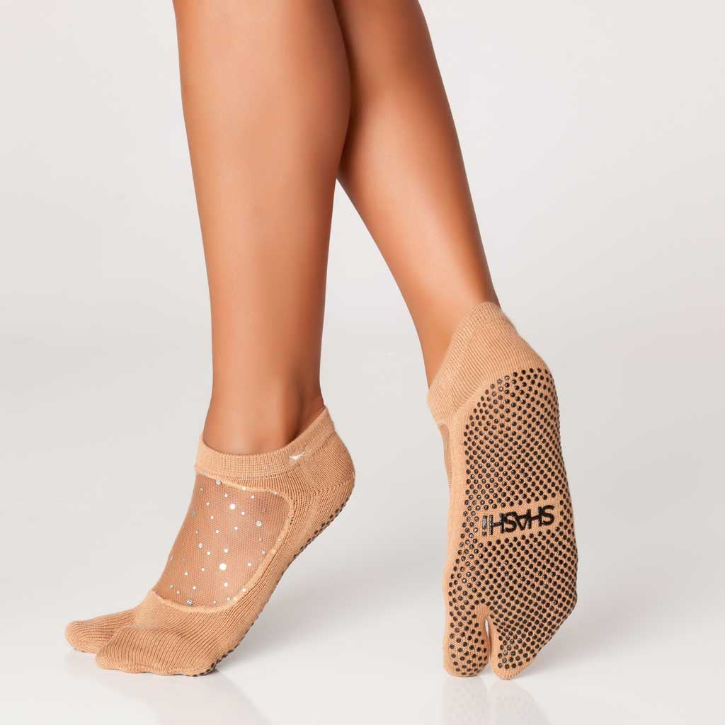 Shashi grip socks in nude with split toe and nude sparkle mesh on top of foot.