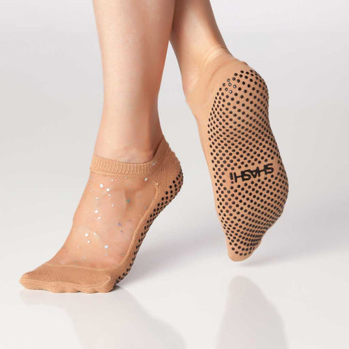 Grip socks with nude mesh and sparkles.
