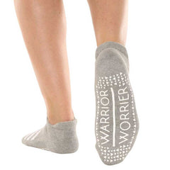 Gray grip socks with warrior - worrier grippies perfect for barre and pilates.