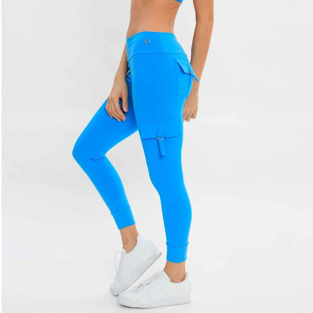 Side view of the Bluefish Sport Cargo Legging in turquoise with pockets.