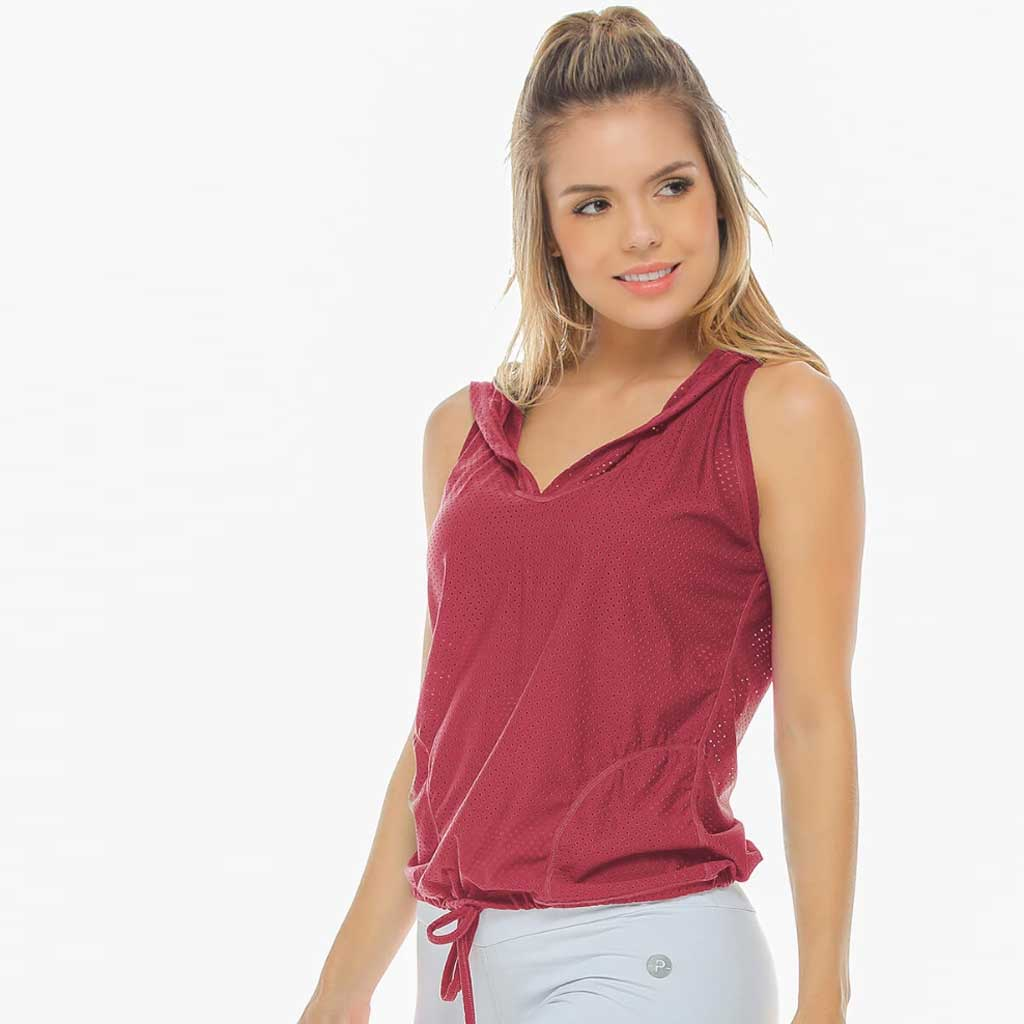 Mesh vest in red with adjustable waistband. It's the perfect lightweight airy vest to wear over your tank or sports bra.