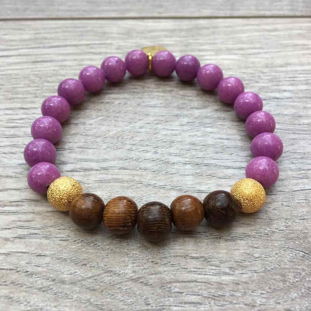 Wooden beads with gold accents and agate beads.