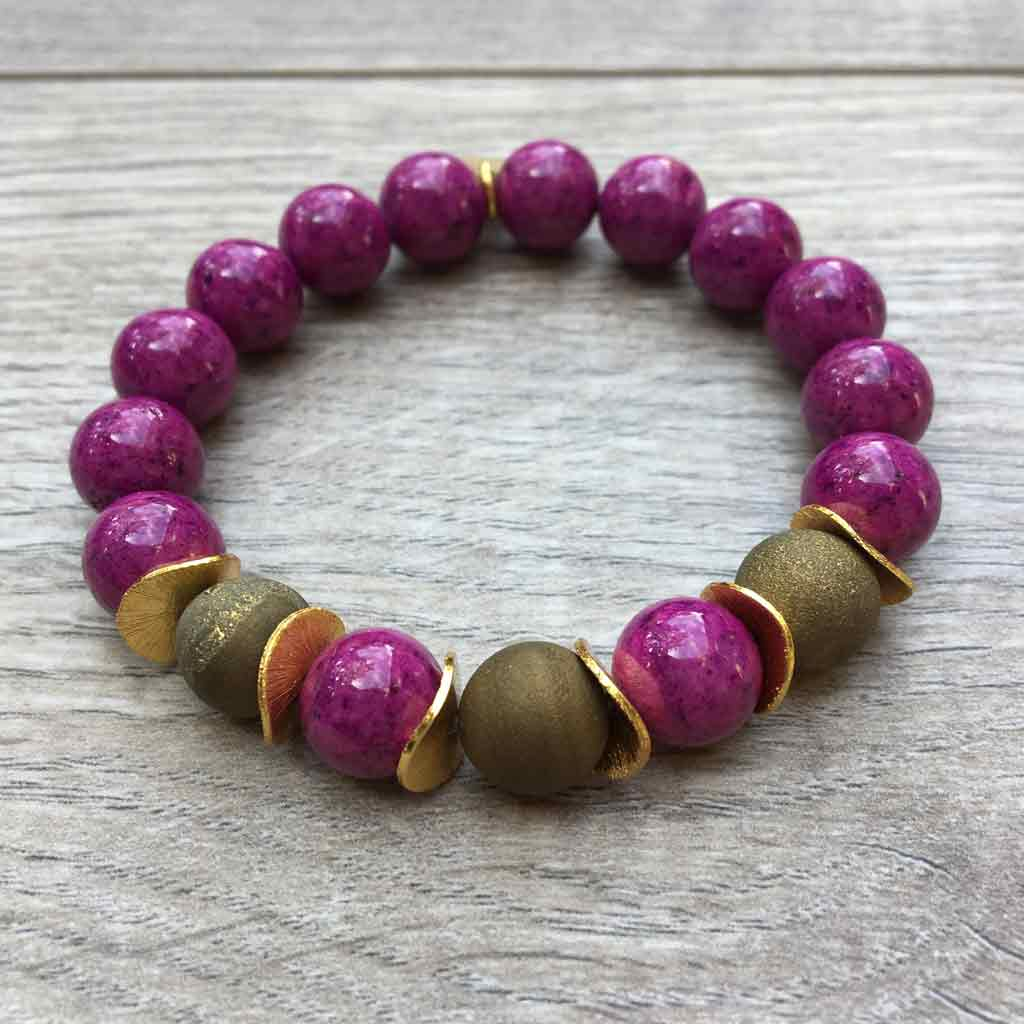 Agate and wooden beads with gold disc accents by JOM jewelry.