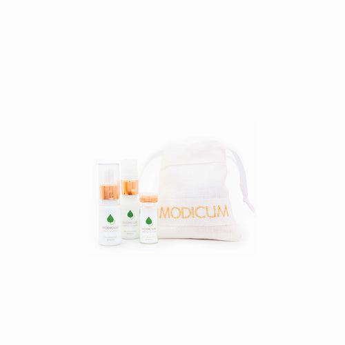 Modicum Skincare Essential Travel kit with cleanser, serum, exfoliant and linen drawstring bag.