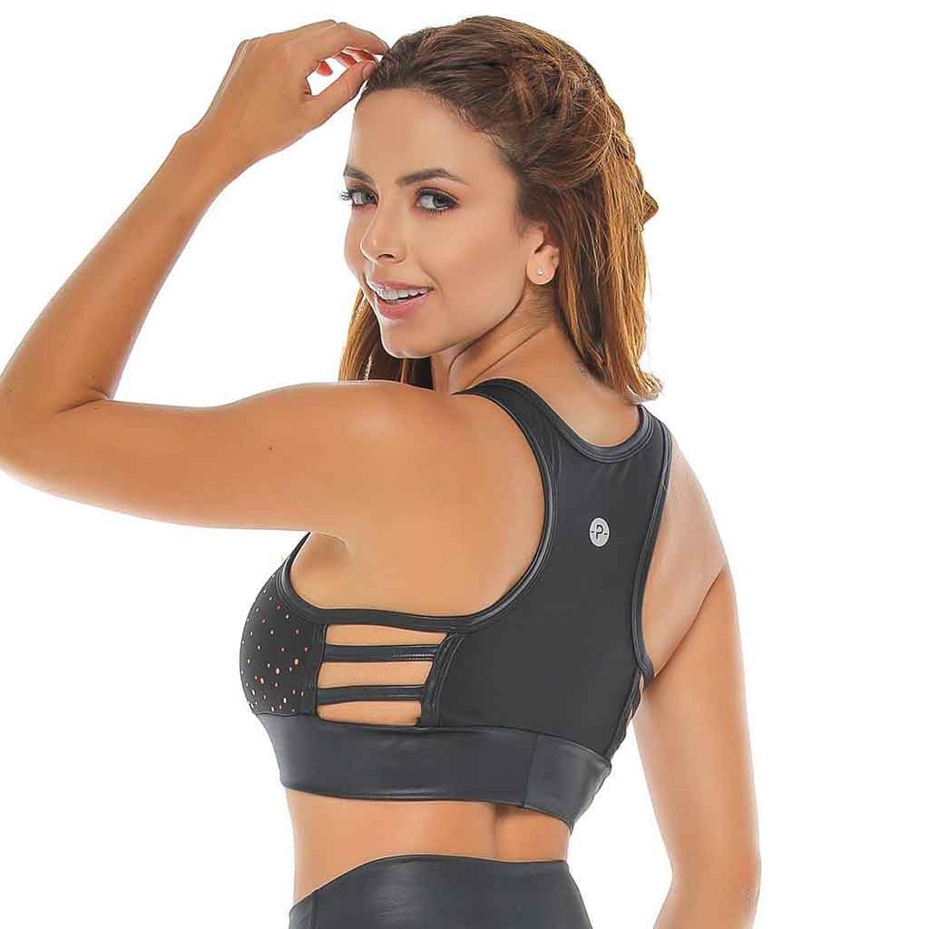 Black sports bra with leather look textures and laser cut dots. This bra features unique straps at the side and a racer back.