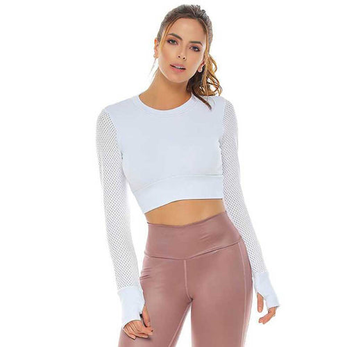 Women's white long sleeve crop activewear top with a flirty back.