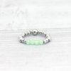 Silver and green stretchy ring