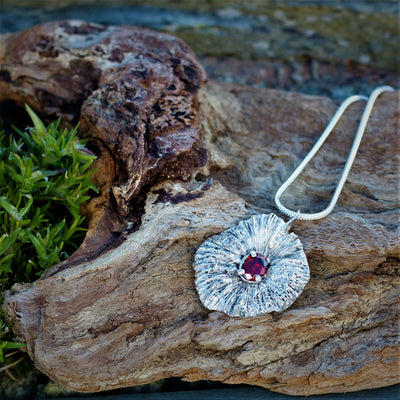 Unique Silver Coral Disk with Garnet Stone