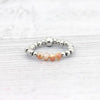 Metal and peach stretchy ring