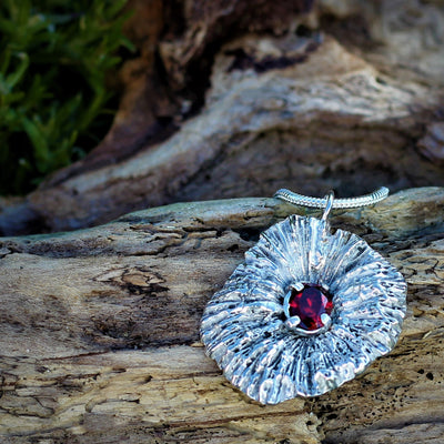 Unique Silver Cast Coral Disk with Garnet Stone
