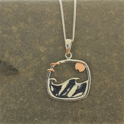 Silver and rose gold pendant with waves, gulls and sunset