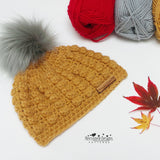 Crochet hat with fluffy pompom