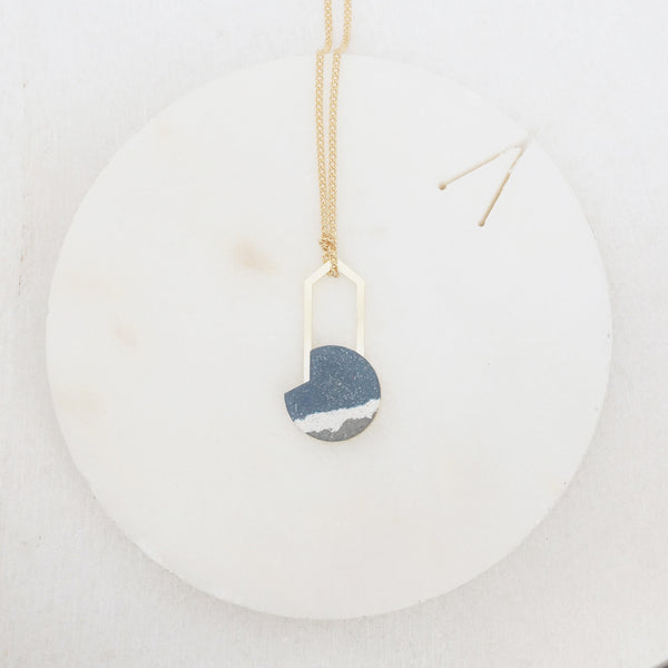 Brass and blue stone graphic necklace