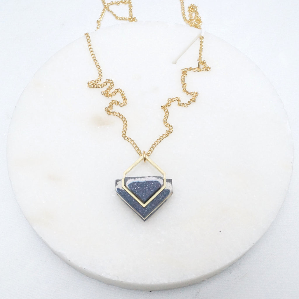 Architectural stone and brass necklace