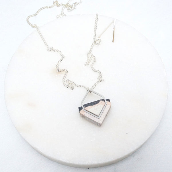 Architectural graphic stone and steel necklace