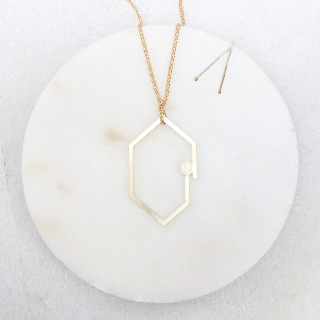 Geometric double hexagon brass necklace