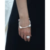 Statement jesmonite stone and steel bangle model shot