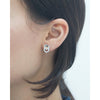 Hexagon steel and stone stud earrings model shot