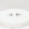 Graphic stud earrings in steel and stone