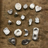 Fingerprint necklaces cast from molten argentium silver