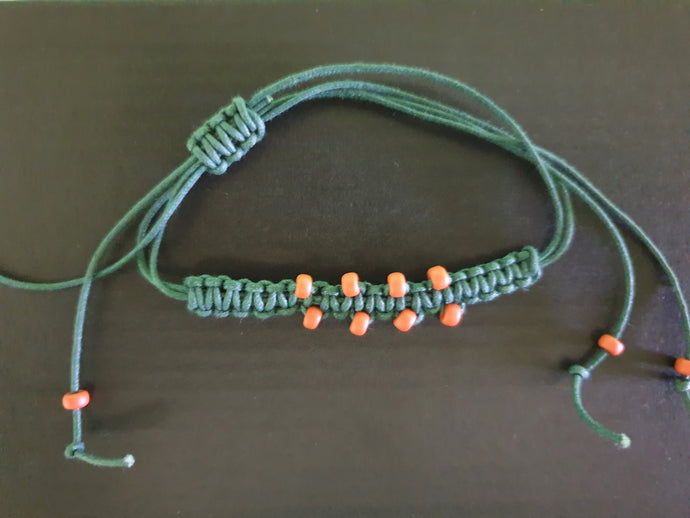 Green Bracelet with Orange Beads