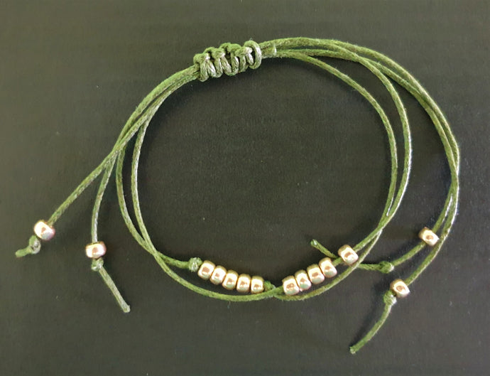 Green Bracelet with Gold Beads