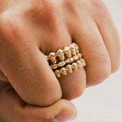 The Sideways Gold Skulls Ring