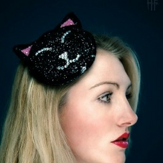a glitter black cat fascinator hat with diamante eyes nose and mouth