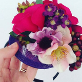purple berries fascinator with pink flowers