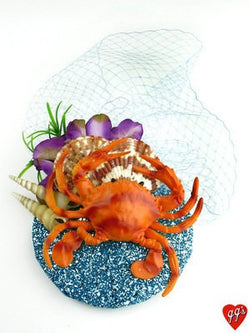 mermaid style fascinator hat with crab and shells