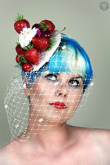 image of strawberry cupcake fascinator with cherries and strawberries and a veil