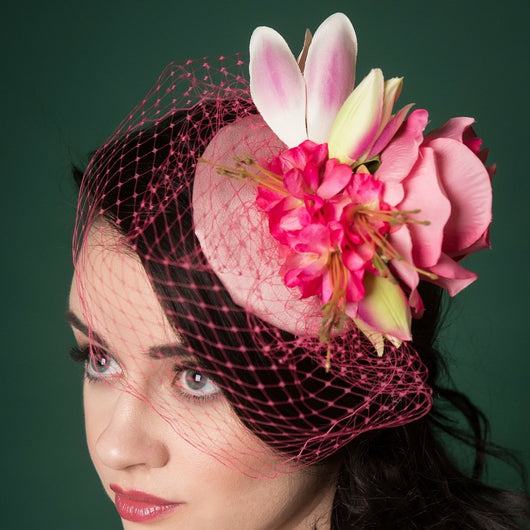 picture of pink floral fascinator with a pink veil
