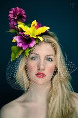 tropical floral fascinator hat in pinks and yellows