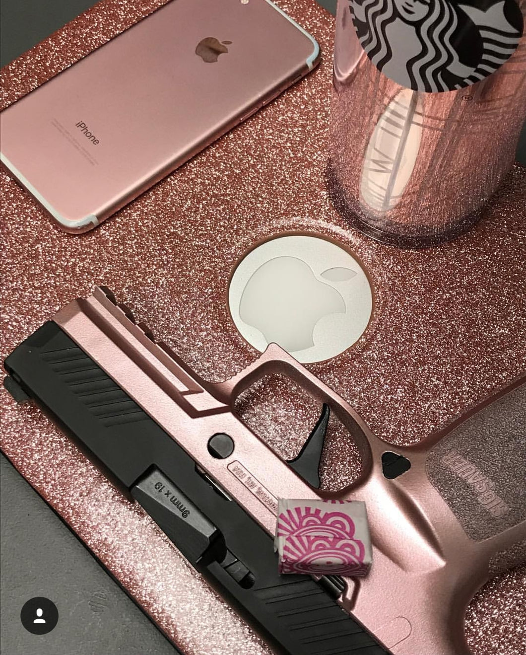 GunCandy Rose Gold, shown with Apple products ( iPhone MacBook )