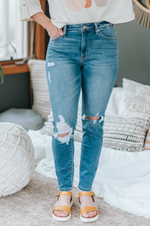 Ivy High Rise Distressed Super Skinny