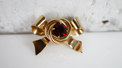 Vintage 1950s Coro Bow Brooch gold red rhinestone
